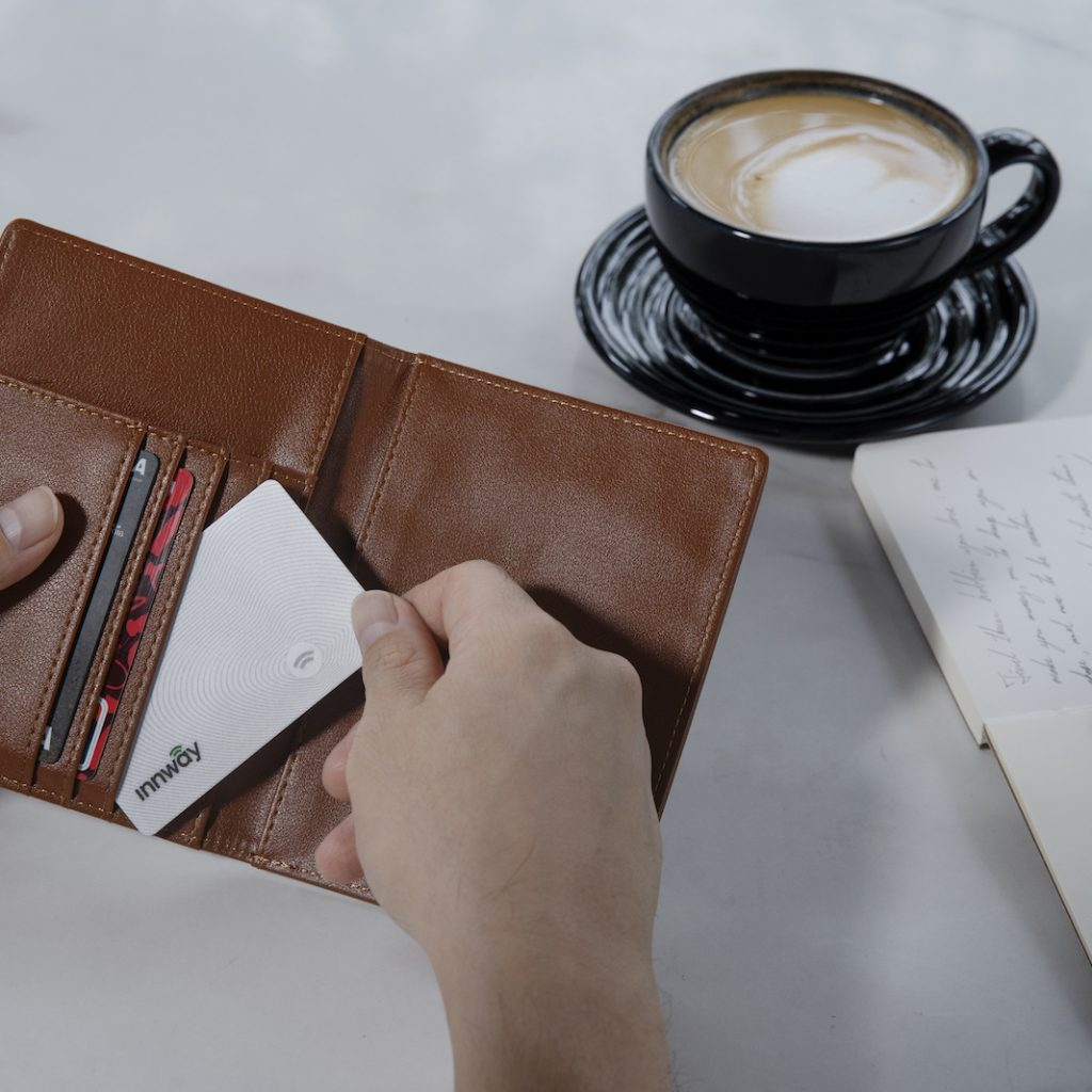 innway-card-white-slotting-in-wallet